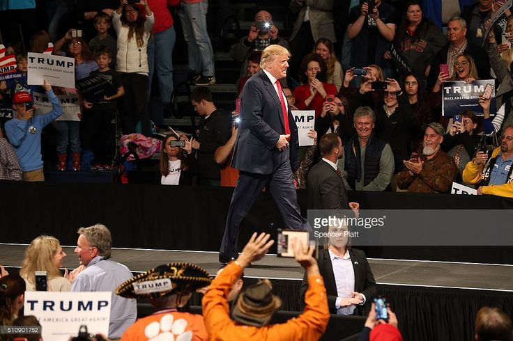 Republican presidential candidate Donald Trump walks onto stage on February 17, 2016 in Sumter, South Carolina. Despite attacks from his fellow candidates about his shifting positions, Trump is still ahead in South Carolina polls only days away from the primary.