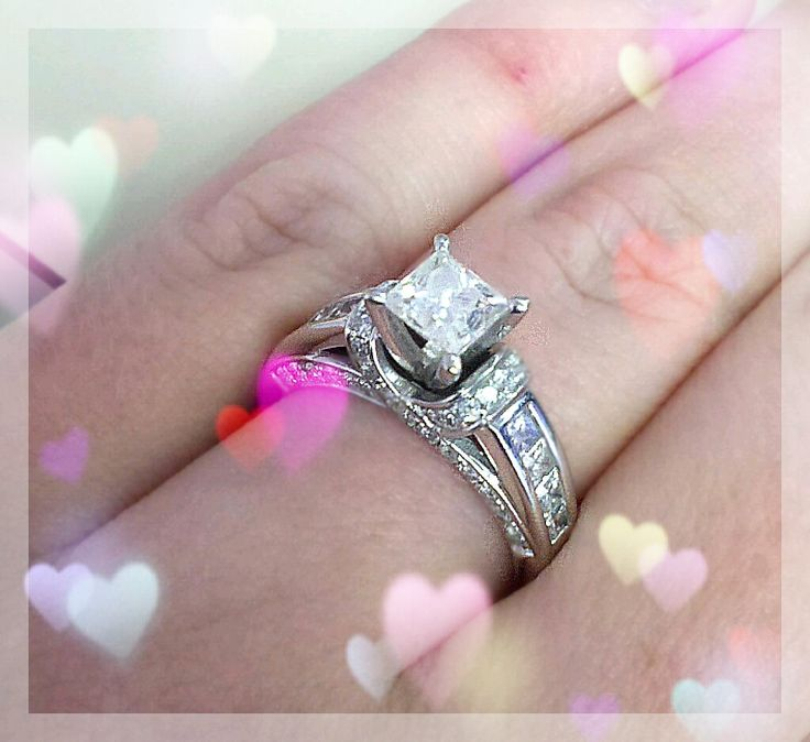 Princess cut engagement ring with 1 carat center stone and round and princess cut diamond on the sides...by Tolkowsky