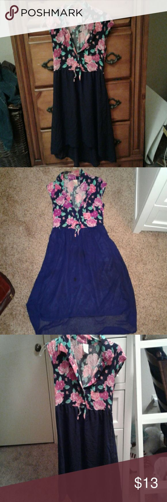 High-Low dress This is a large, high-low kids dress.  Hardly worn. The bottom is navy blue.  The top is navy with roses.  Very fun and  dress. Faded Glory Dresses Casual