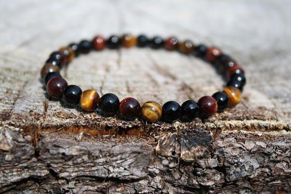 Stabilizing and Grounding Bracelet:  Black Onyx, Tigers eye, Red Tiger's eye .  Genuine Power Stones Juzu mala Bracelet.