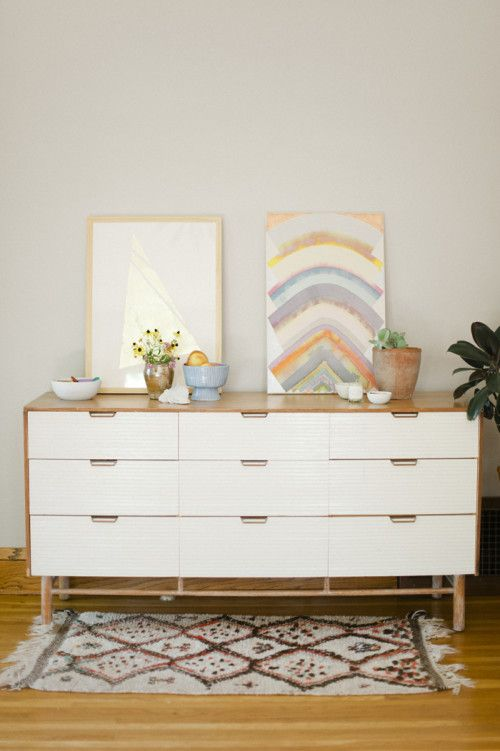 This dresser was a mid century find from Golden Age Design and serves as a catch all for the daily clutter. The painting is Hadley Holiday and the gold leaf artwork by Siri Knutson.