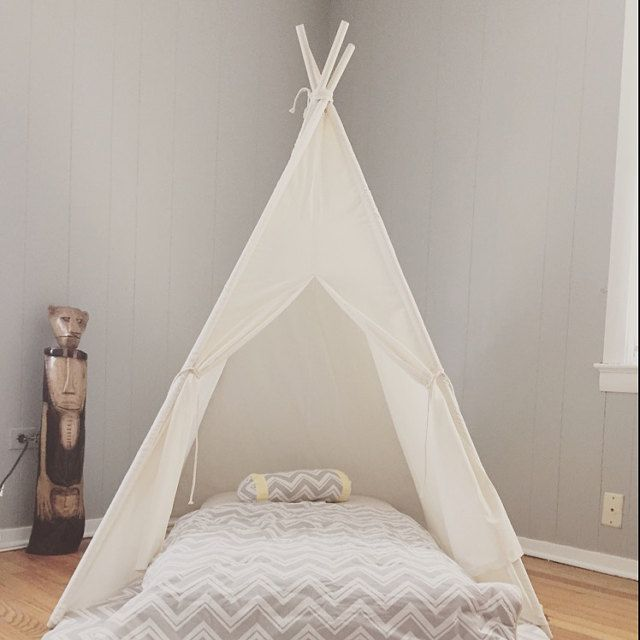 Lightweight muslin teepee used as a bed canopy - great idea!