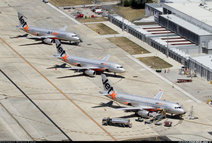 Jetstar Airways Airbus A320-232 sister ships VH-VQV, VH-VQG and VH-VGP all together on a busy day at Launceston Airport, January 2013. (Photo: Martin Eadie)