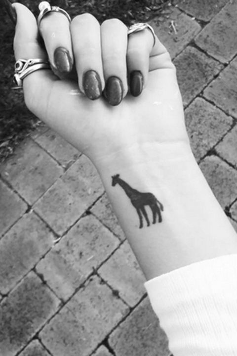 Small giraffe tattoo