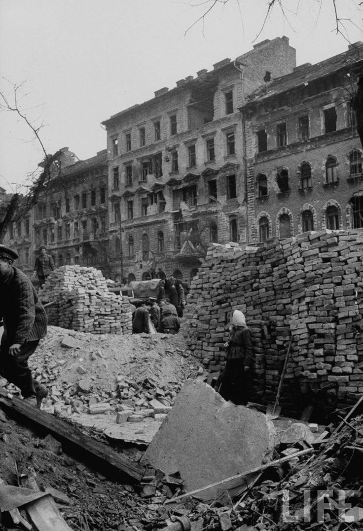 Budapest during first aftermath of attack, ruined buildings, people wandering around. - 1956