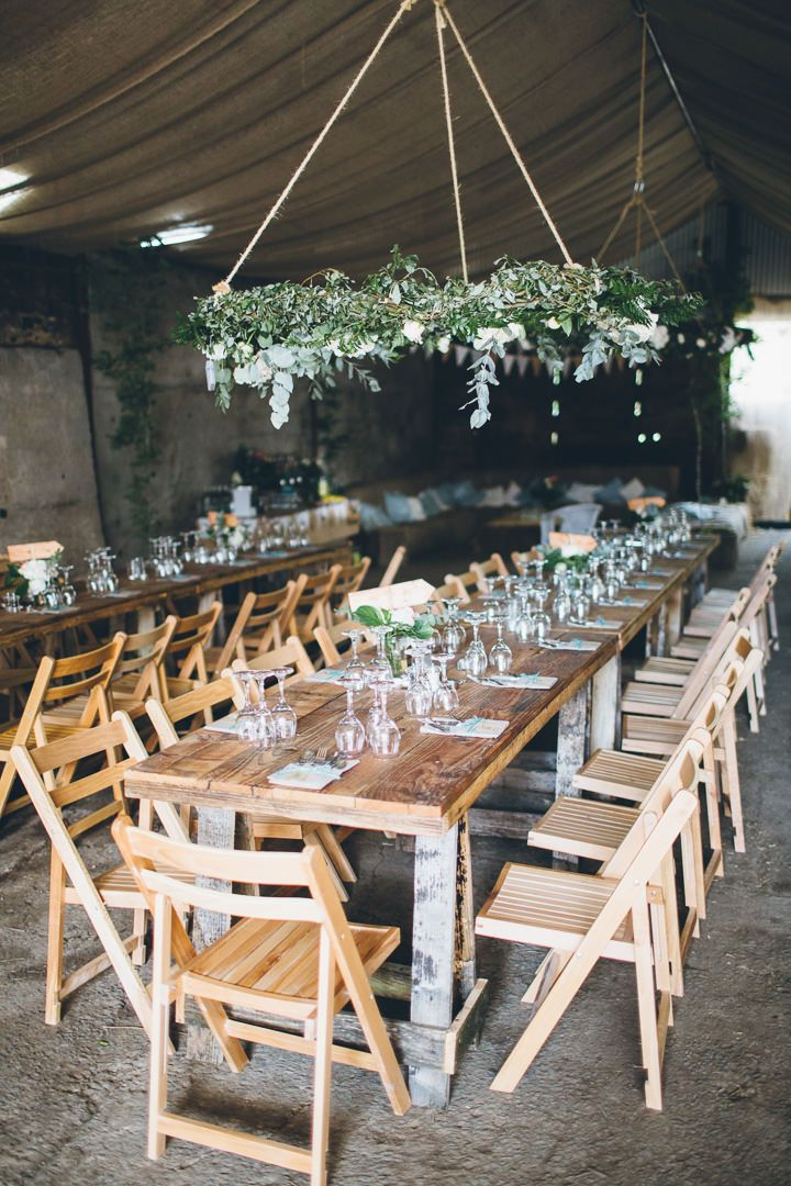 Twist on rustic centerpiece...hang planters above tables. Touch of elegance. | Ceri and Nick's Rustic Chic Welsh Farm Wedding By Mike Plunkett Photography