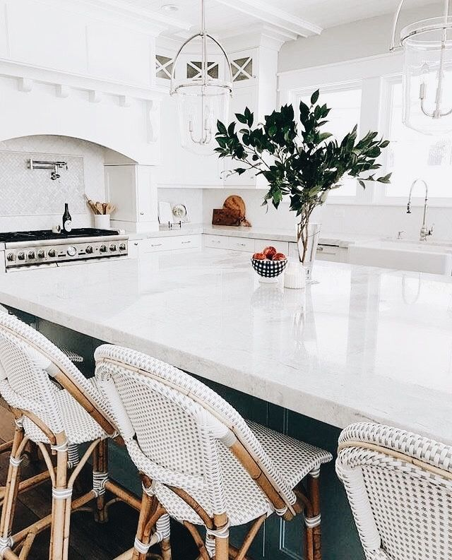 Summer style!! gorgeous WHITE kitchen - love the white and rattan bar stools! This is a really elegant kitchen!