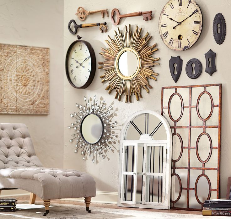 How gorgeous is this? Create a gallery wall that catches the eye with everything from mirrors to clocks to decorative keys. HomeDecorators.com