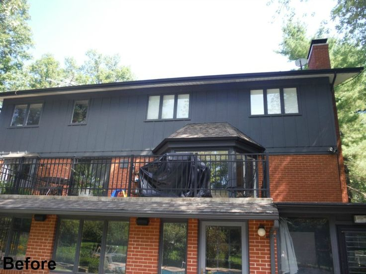 Back deck before picture with old Masonite Siding
