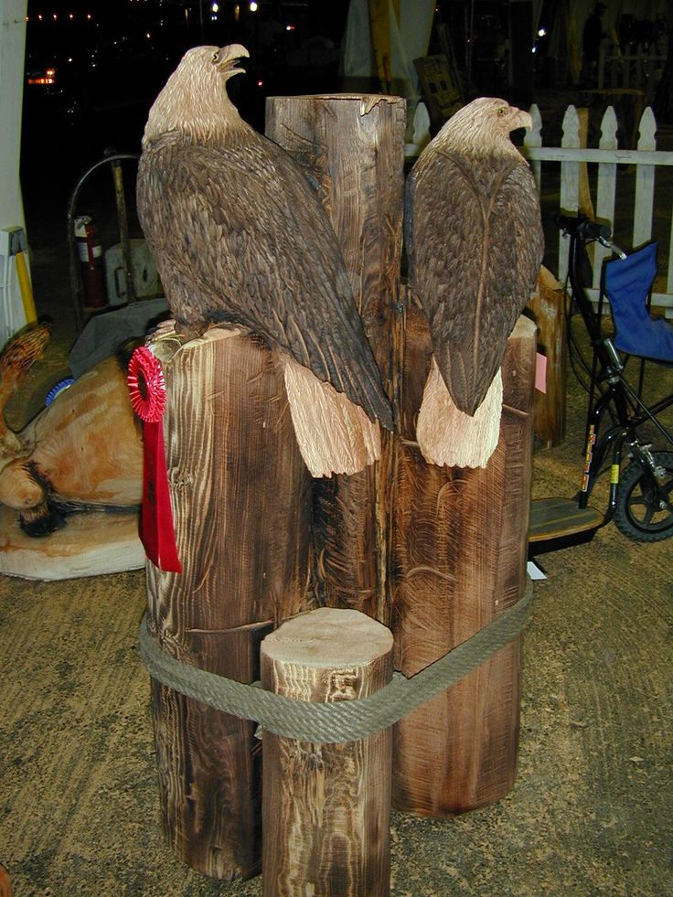 chain saw art | Eagles on Piling