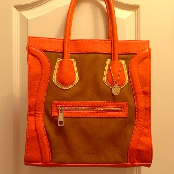 NWT Big Buddha Skye Bag NWT Orange, Brown, and Gold Big Buddha Bag. Nice long handles that actually stay on your shoulders and a big funky printed interior with a zipper and cell phone pocket. Side snaps to make the bag larger or smaller. Could easily be used as a cute laptop bag. Big Buddha Bags