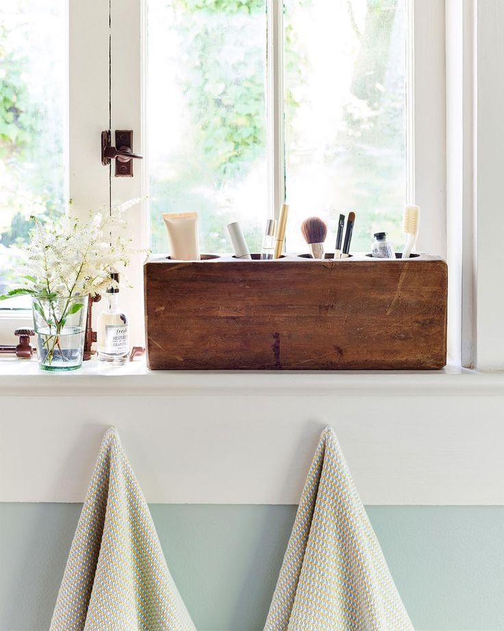 countrylivingmagWho would have thought an antique sugar mold could make the perfect bathroom organizer?! (: Brian Woodcock) #homedecor #makeupstorage