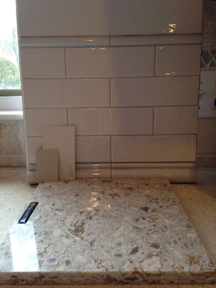 Cambria Windermere quartz countertops, subway tile backsplash, BM Revere Pewter or Pashmina on walls.