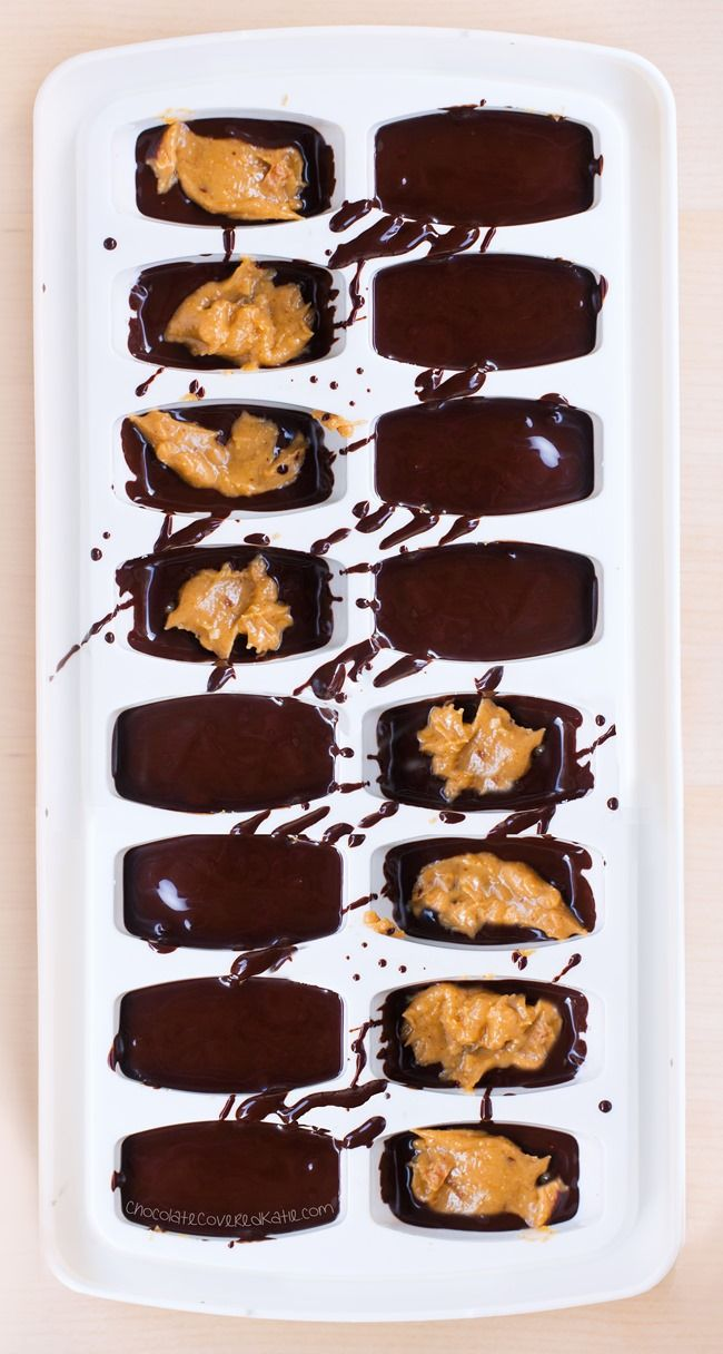 SO cute & easy - Irresistible chocolate peanut butter candy cups, made with an ice cube tray for whenever a craving hits ... http://chocolatecoveredkatie.com/2016/02/29/ice-cube-tray-chocolate-peanut-butter-cups-recipe/ @choccoveredkt