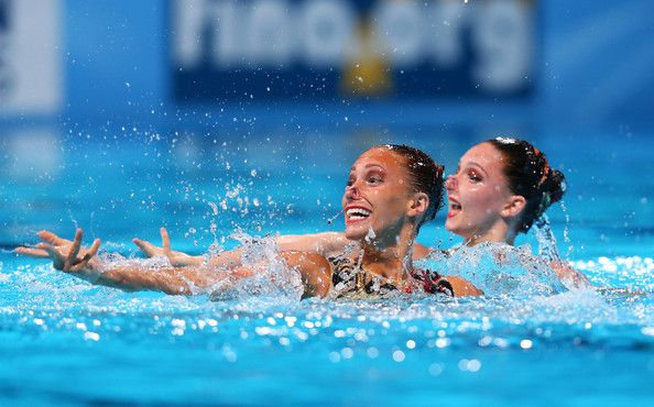 Jenna Randall and Olivia Federici of Great Britain compete in the Synchronized Swimming Duet Technical preliminary round on day two of the 15th FINA World Championships at Palau Sant Jordi on July 21, 2013 in Barcelona, Spain.