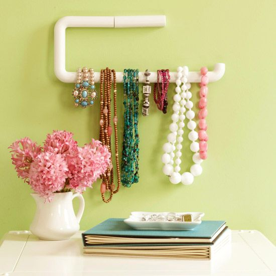 Jewelry hanging from a paper towel bar