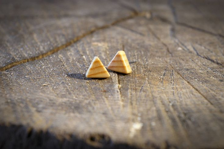 Love the grain and colour in this Triangle Wooden Stud Earring - Poplar, Handmade, Gender Neutral. Click to see more in different woods like walnut and other designs.