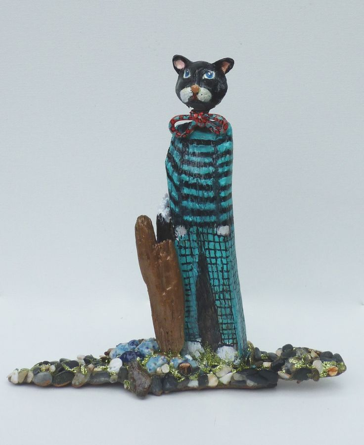 Driftwood and ceramic sculpture by dorienne  Title Smart cat
