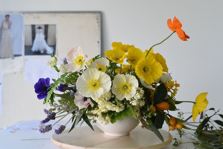 large colourful centrepiece with poppies, jonquils, daffodil, anemones, kumquat, lavender