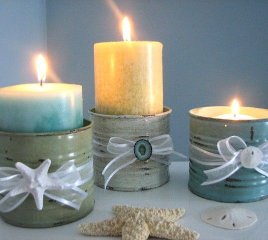 I can see using recycled tin cans painted then scuffed up a bit as candle holders. If you have a vintage, shabby chic or beach wedding these would be charming.