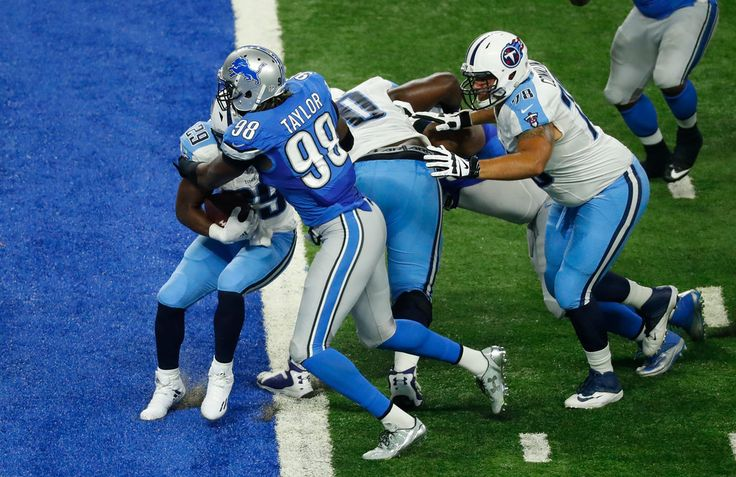 Detroit Lions defensive end Devin Taylor (98) tackles Tennessee Titans running back DeMarco Murray (29) for a safety during the first half of an NFL football game, Sunday, Sept. 18, 2016, in Detroit. (AP Photo/Paul Sancya)