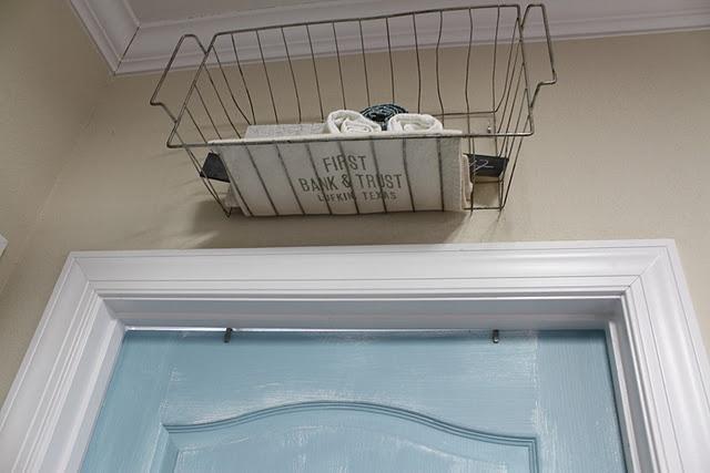 I love the wire basket above the aqua door!