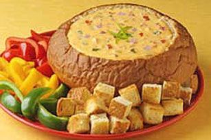 Cheesy Hawaiian Dip recipe   1 round loaf Hawaiian bread (1 lb.)  1 lb.  (16 oz.) VELVEETA®, cut into 1/2-inch cubes  1 can  (10 oz.) RO*TEL Diced Tomatoes & Green Chilies, undrained  1/3 cup  chopped red onions  1 pkg.  (8 oz.) OSCAR MAYER Smoked Ham, chopped  1 can  (8 oz.) crushed pineapple, drained