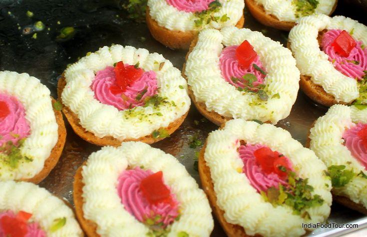 Seasonal sweets on display in a sweet shop in India.