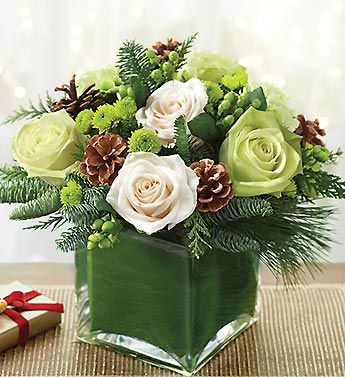 Set the table this winter in a truly original way with our Winter Wonderland arrangement featuring winter flowers with pine cone accents.