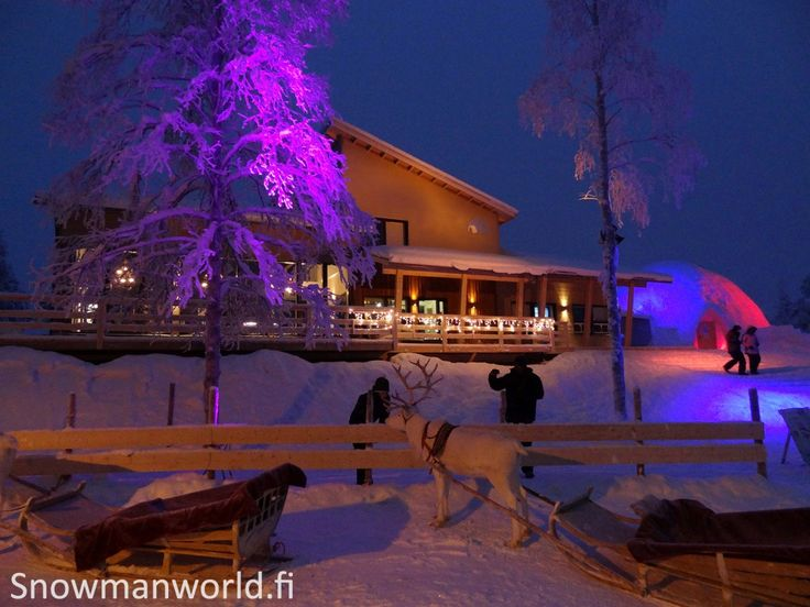 """The reception building of the Snowman World during the """"blue moment"""" in Santa Claus Village in Rovaniemi in Lapland."""