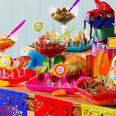 Bring the heat with a salsa station! Oversized and mini glasses spice it up at the fiesta. Click for sizzling salsa recipes!