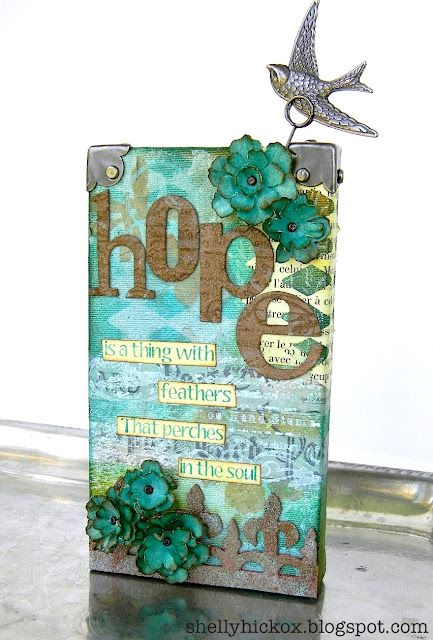 Altered wood block made with sticky back canvas, Sizzix dies, Artistic Outpost stamps, and Tim Holtz everything.