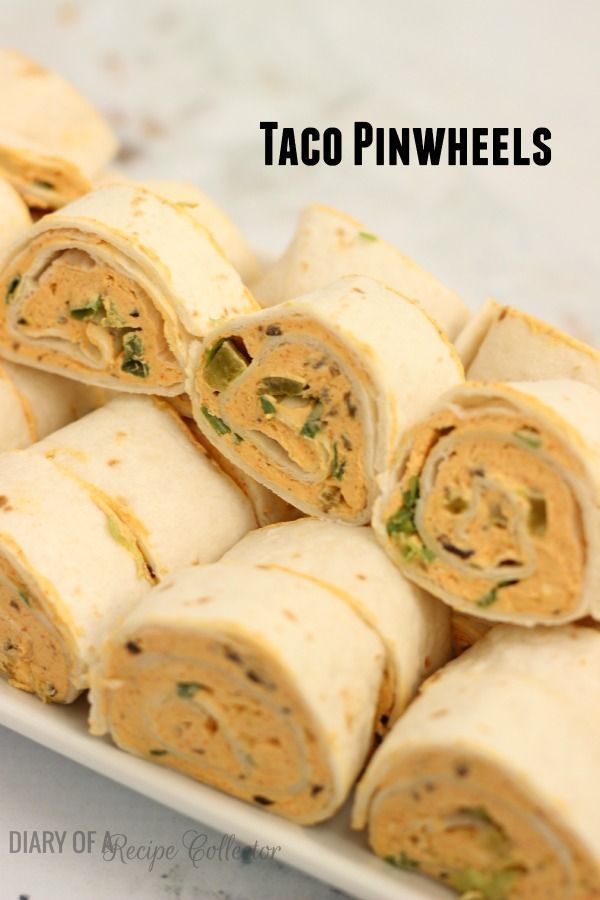 Taco Pinwheels - A perfect appetizer for your next gathering! Flour tortillas filled with a taco seasoned cream cheese mixture and full of spicy flavors!
