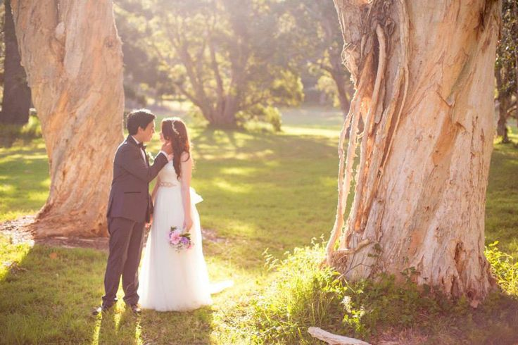 Natalie & Kevin - The bride & groom wandering around Vaucluse House gardens. Photography by Mint Photography