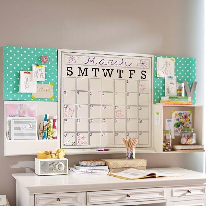 I love the giant wall calendar. I love the shelves. And I love the cork board tiles. I prob would leave them brown instead of covering with fabric
