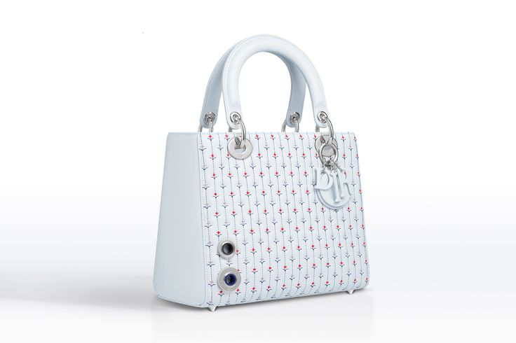 """Lady Dior"" bag in Bleu Céleste quilted lambskin Embroidered with flowers and stripes, Dior signatures Silver-tone metallic jewellery and eyelets Can be carried in the hand, on the shoulder or across the body Size: 24 x 20 x 11 cm #dior2015"