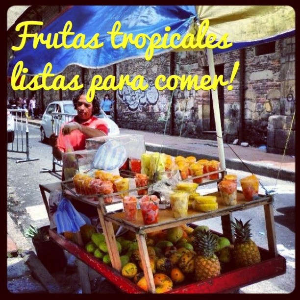 Tropical fruits ready to eat! - A street seller close to 'La Plaza de Bolivar' in Bogota, Colombia