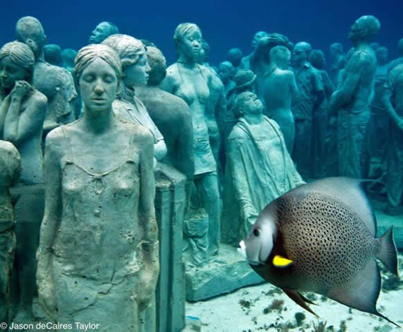 Underwater sculpture in Grenada, memorializing Africans who jumped or were forced overboard during the middle passage.  Intended as a foundation for new coral reef growth.