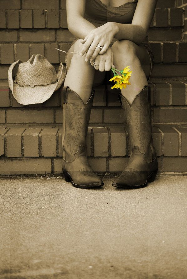 Boots. Some day I'll be the one sitting there with real american boots n hat. And my love who gave me those flowers!