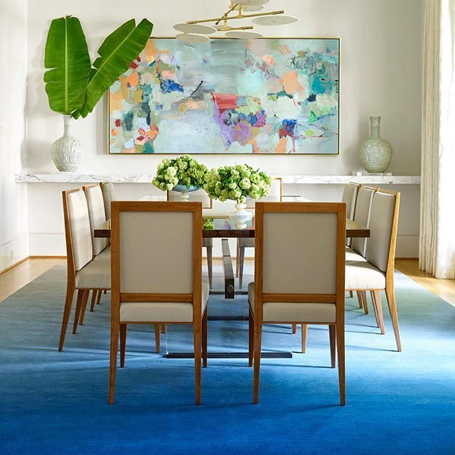 Bright And Colorful Dining Room With Blue Rug Abstract Art