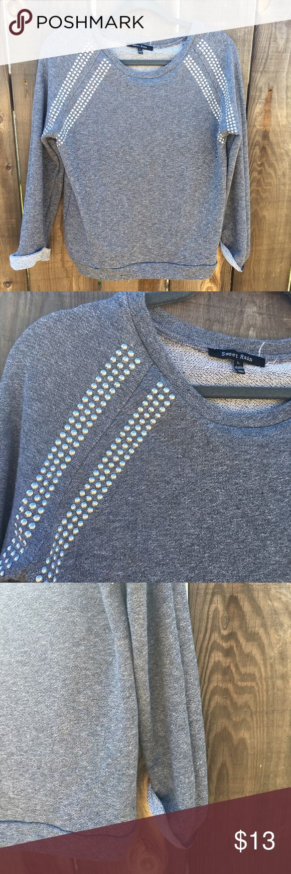 Relaxed grey sweater with studs Can wear sleeves cuffed or relaxed. Soft, grey. Metal studs. Size large but will best fit a small-Med for slouchy relaxed look. Tops Sweatshirts & Hoodies