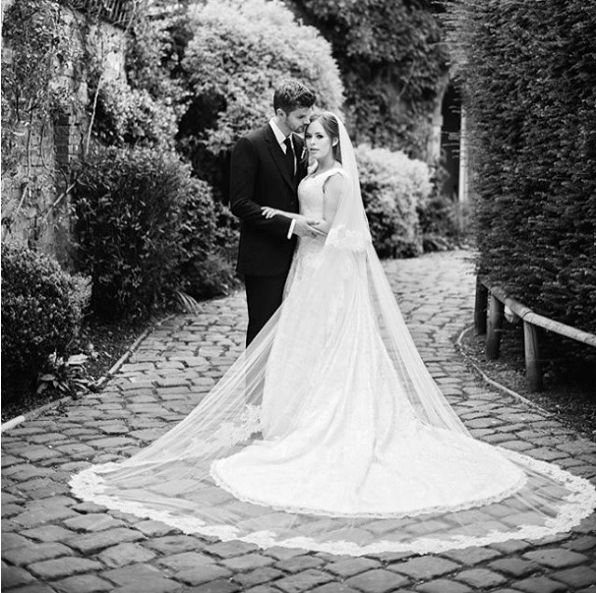Tanya Burr  Beauty vlogger Tanya Burr wore a classic Philippa Leply to wed fellow Youtube Jim Chapman. We love the lace edge cathedral veil.