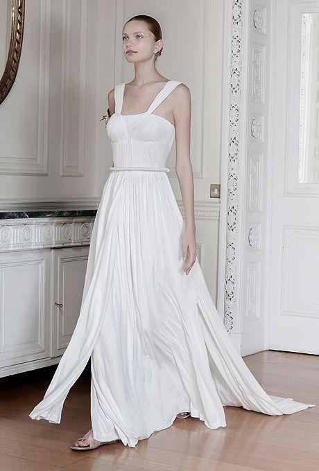"Brides.com: . ""Euridice"" sleeveless silk taffeta A-line wedding dress with a square neckline, ruched bodice, and flowing skirt, Sophia Kokosalaki"
