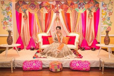 rajasthani decor, pink and yellow curtain drapes, pink cushions, traditional umbrellas
