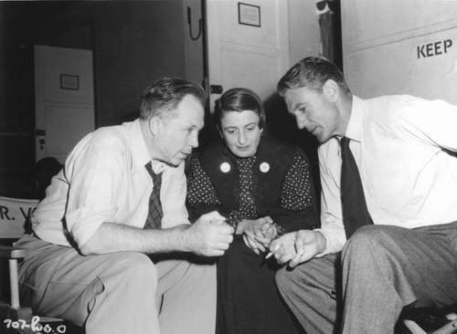 "Director King Vidor, author Ayn Rand and Gary Cooper discussing ""The Fountainhead"", 1949."
