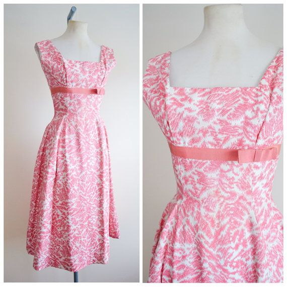A fun formal dress from high quality designer Frank Usher, in mid weight faille-esque fabric with abstract print in candy pink! Nipped in waist with