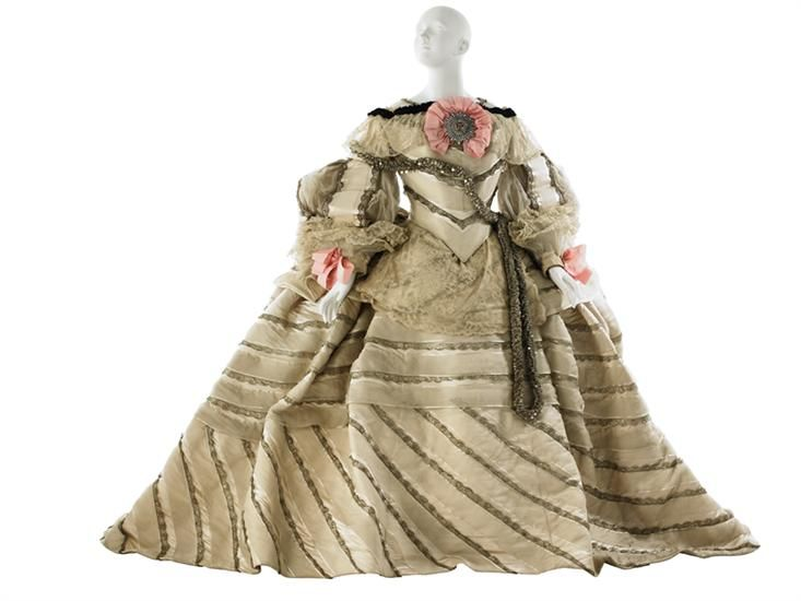 """Fancy Dress Costume, """"Infanta Margarita after Velasquez,"""" House of Worth: 1897, satin overlaid with alternating rows of organza ribbon and galoon d'argent bands, organza, machine-made lace, metallic """"lei"""" with spangles, taffeta ribbon, brilliants, velvet ruched ribbon, rhinestone backed by taffeta cockade."""