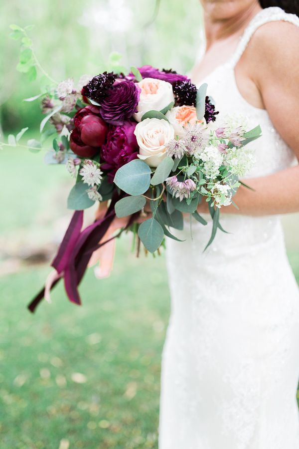 deep purple bouquet - photo by Rosenlee Photography http://ruffledblog.com/glamorous-country-chic-wedding-inspiration #bouquets #weddingbouquet