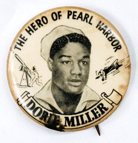 *WWII pin honoring Pearl Harbor hero Dorie Miller, a black messman who was untrained in machine gun use due to rigid Naval segregation policies. Miller took over a machine gun aboard the USS West Virginia and was officially credited with downing two Japanese planes. He was honored as one of the first heroes of World War II, and six months after the attack was given the Navy Cross by Admiral Chester Nimitz.