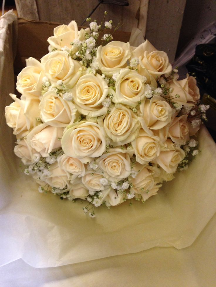 Hand ties bouquet using Champagne Rose's and gypsophila .